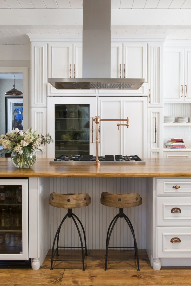 Remodel stories in this fabulous double kitchen remodel across