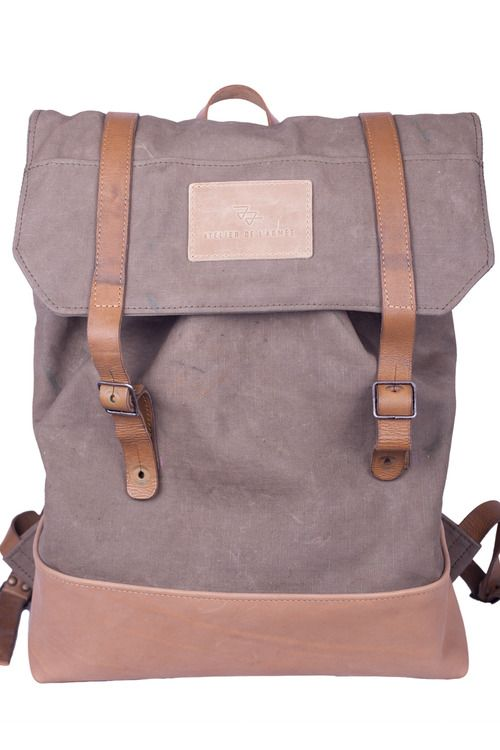 Atelier de lArmée handcrafted military backpack 185 - made out of a dutch army ripstop transporter bag with a naked leather bottom and two french army leather rifle sling handles - for sale via atelierdelarmee.com