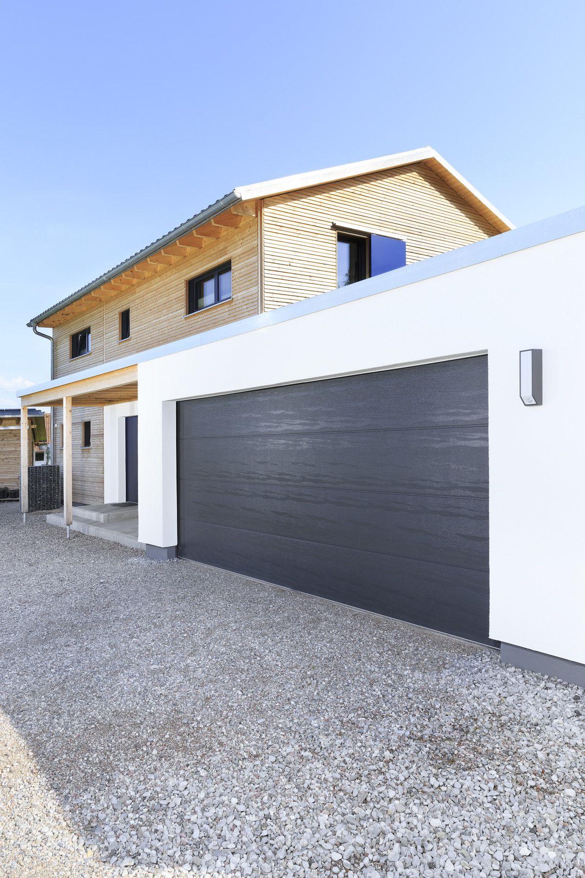 Fertighaus Mit Doppel Garage Haus Schneider Von Baufritz Einfahrt Garagentor Baufritz Haus Haus Mit Garage