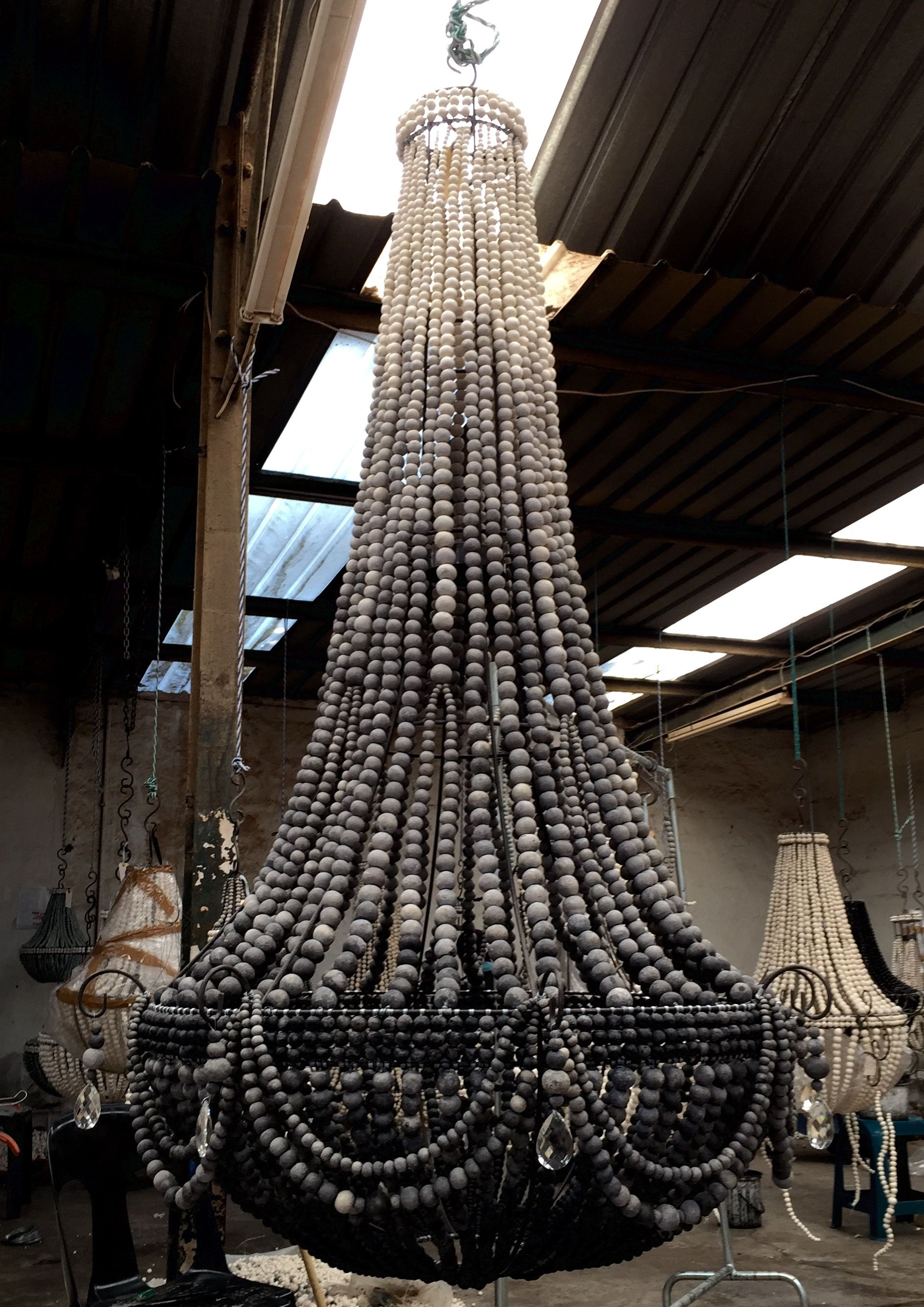 chandelier empire wood au wooden courant interiors kayla beaded products