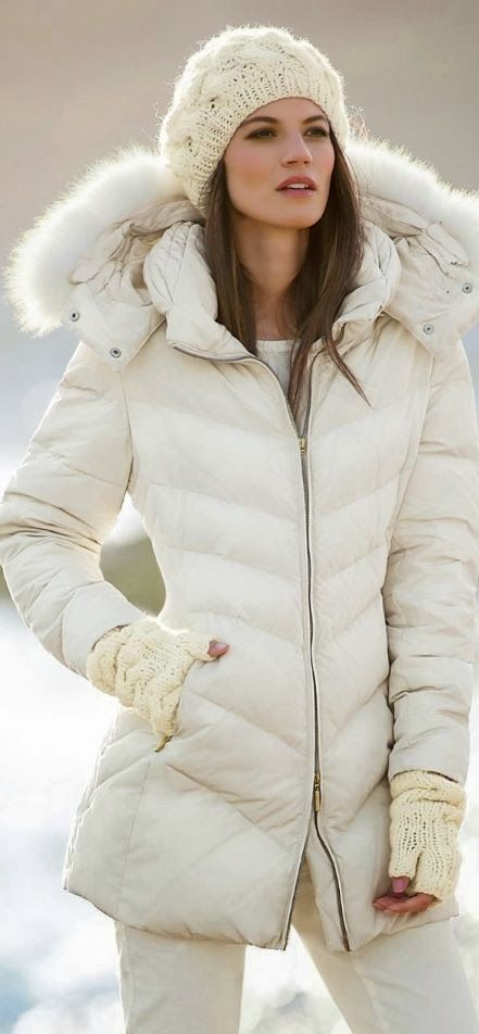 e7a690efc3 Stunning women's winter fashion! White puffer coat fur lined hood, white  skinny jeans and knit hat. Winter Chic outfit!