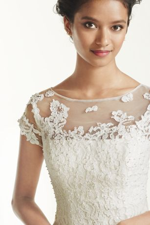 84901bc2635a Take short and sweet to a whole new level in this lace cap sleeve tea-length  wedding gown! Picture perfect for an outdoor wedding or reception dress, ...