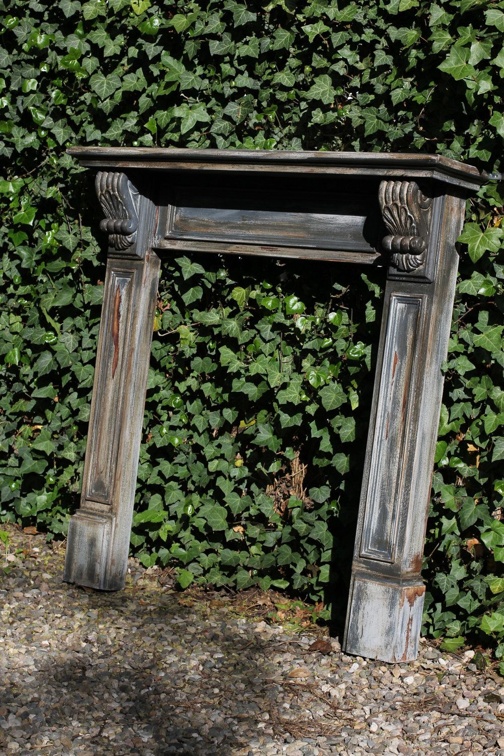 Carved Wooden Steam Punk/Shabby Chic Painted Fireplace Surround. £260.00, via Etsy.