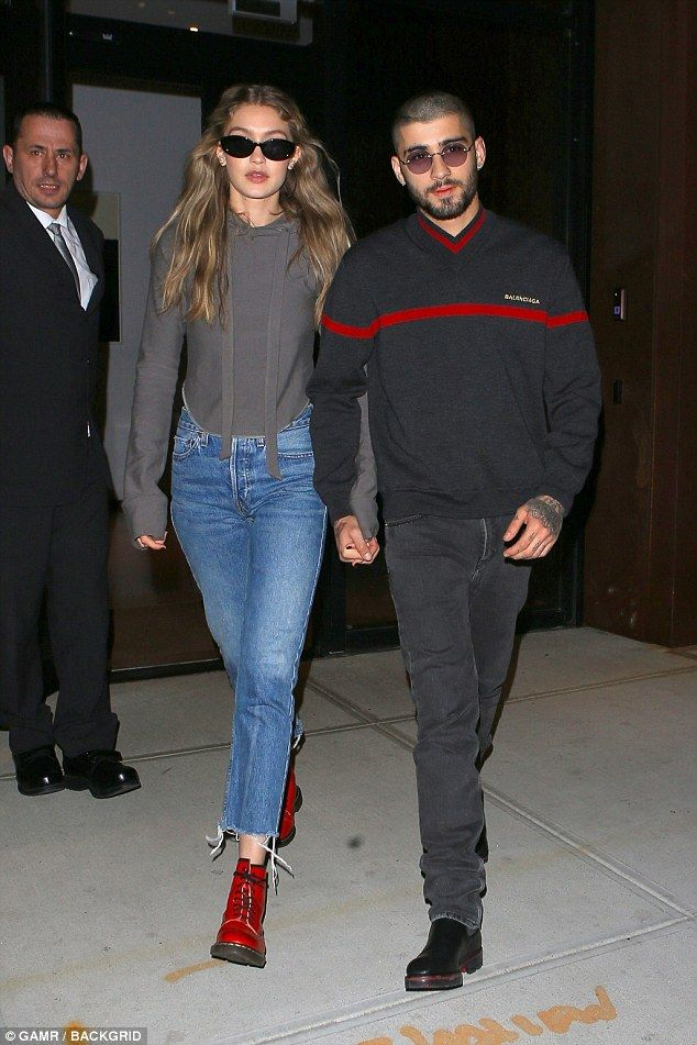 d50f77df Besotted: Gigi Hadid and Zayn Malik appeared closer than ever on Thursday  as they headed out hand in hand in New York City