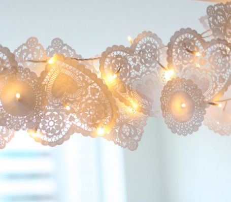 String heart-shaped doilies with white lights for some pretty Valentine's Day mood lighting.