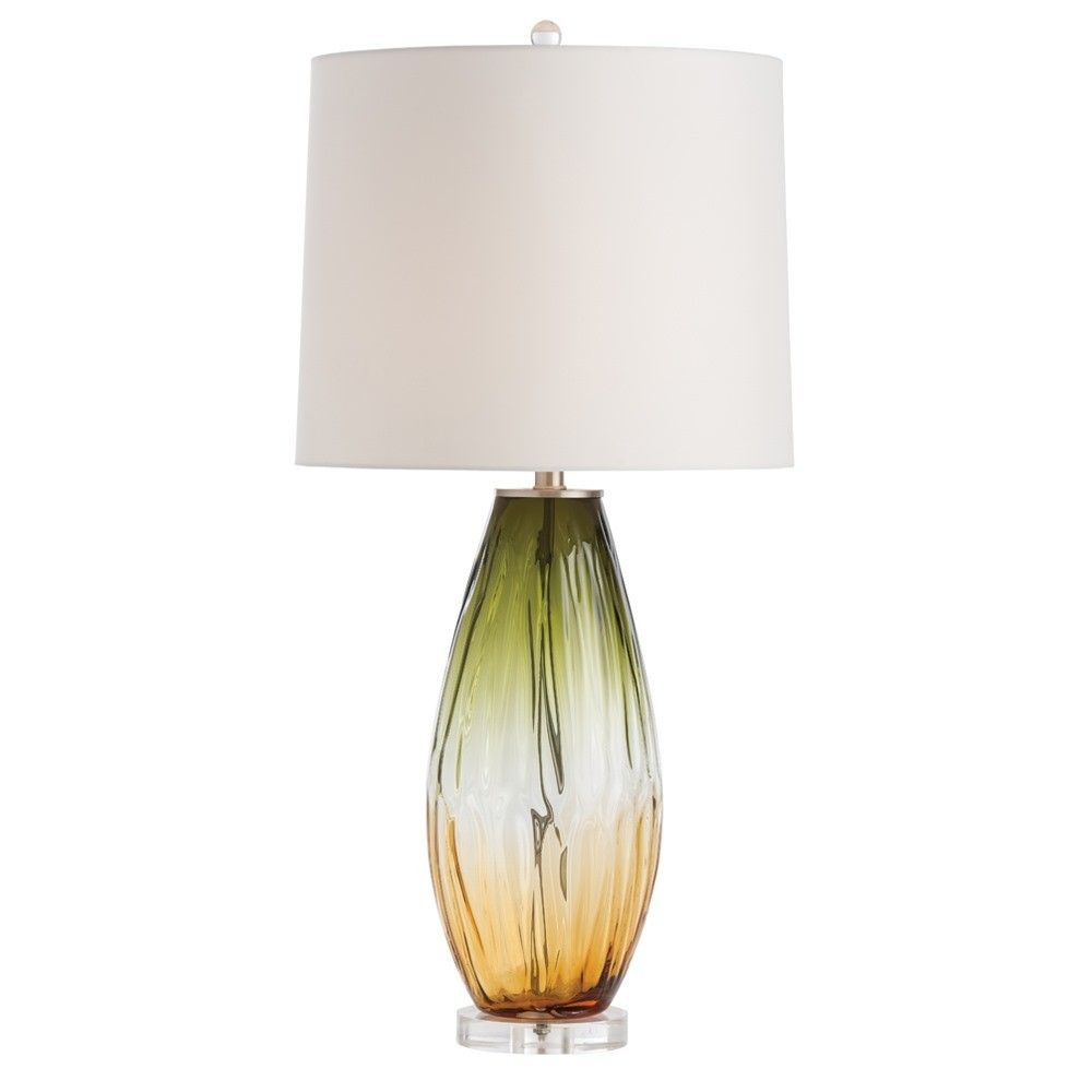 """A unique olive and amber ombre finish adds warmth and depth to this mouth-blown glass lamp, with the clear acrylic base adding a touch of elegance. Perfectly sized for a living room or seating area. Topped with a lined ivory microfiber drum shade. Finish may vary.    Material: Glass  Finish: Olive and Amber Ombre  Shade: Ivory Microfiber Round Drum  Shade Dimensions: 15""""W Top x 16""""W Bottom x 13""""H"""
