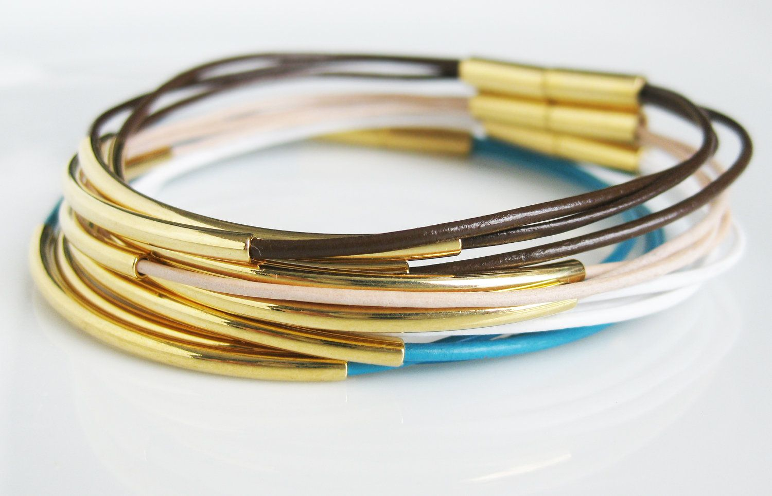 Interesting use of tube beads overu jewelry cord leather