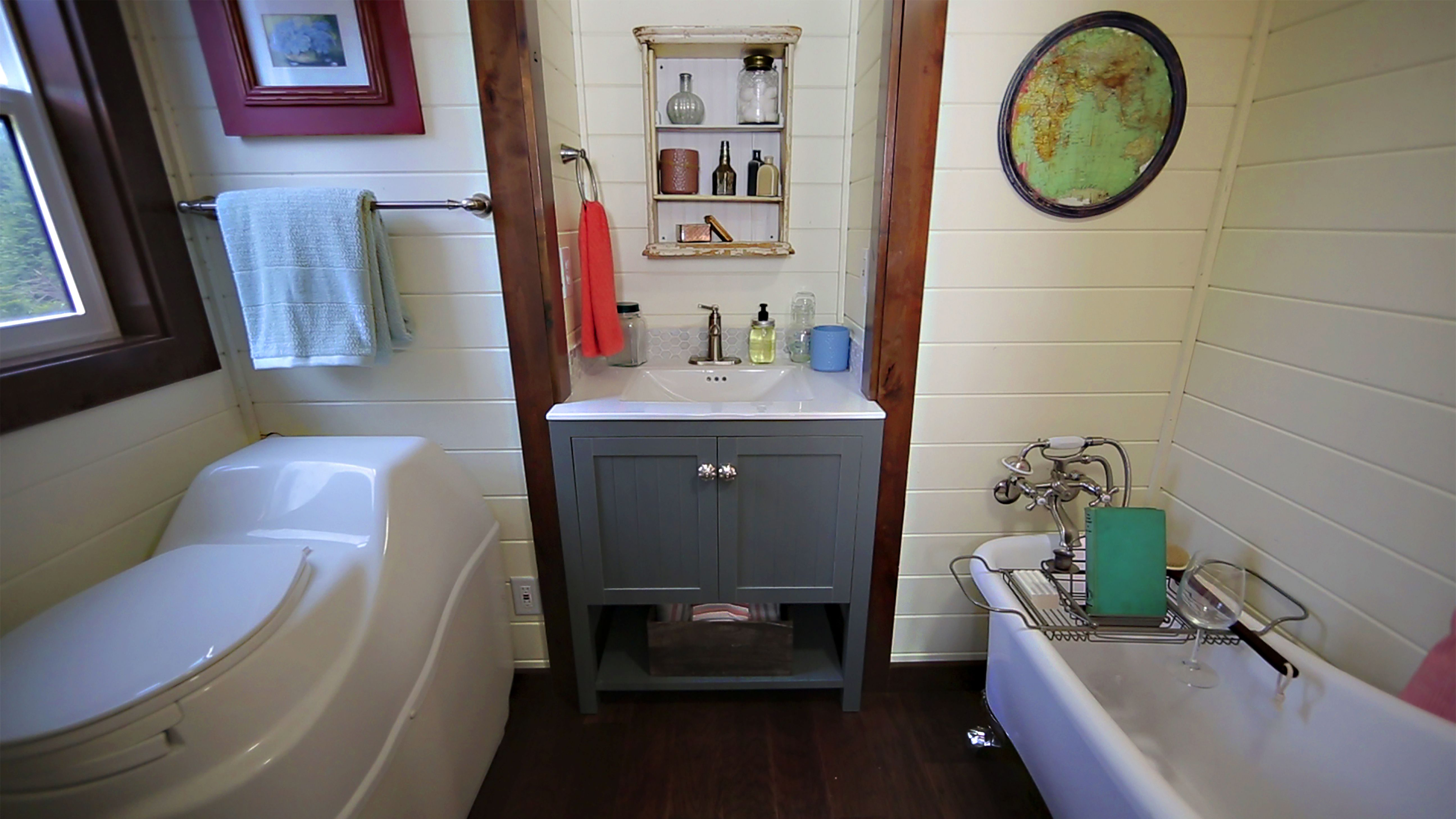 Beautiful bathroom with clawfoot tub in this tiny heirloom for Beautiful tiny bathrooms