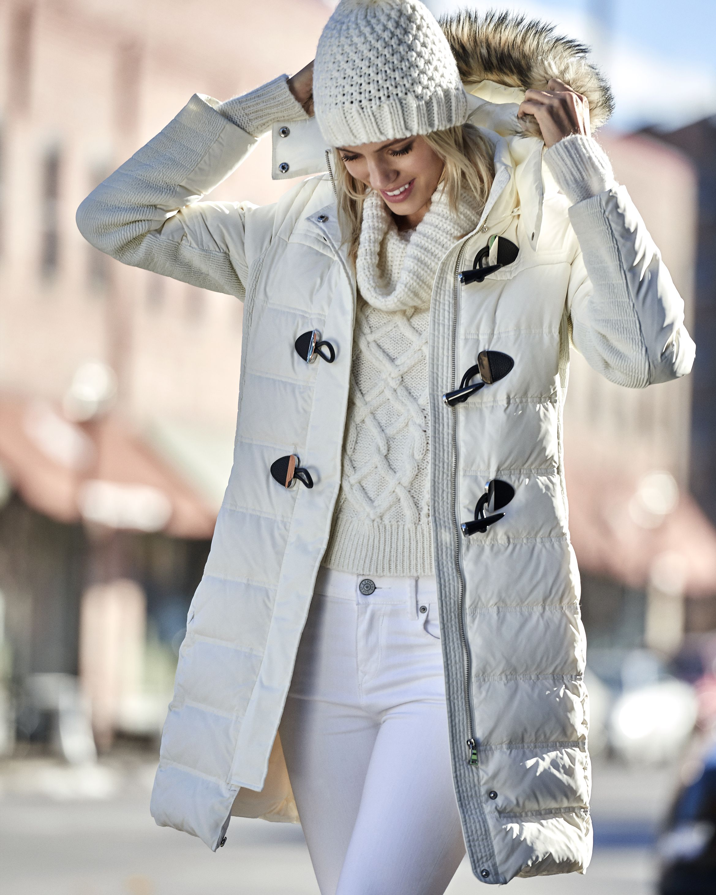 Ample warmth and coverage in a smart and flattering style. This down coat's fitted look is supported by smocking at the waistline and complemented by three polished toggle closures and a faux fur-lined hood.