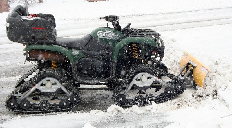 Yamaha Grizzly 750cc with Tracks and a plow For The Snow