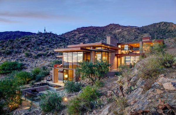 Multi Level Desert Home Organically Forms Into The Mountainside Houses In Phoenix Arizona Desert Homes Lake Houses Exterior