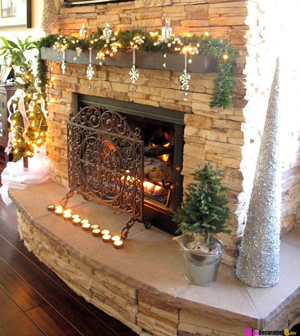 Rustic christmas themed mantel decoration with green for Over the mantel decor