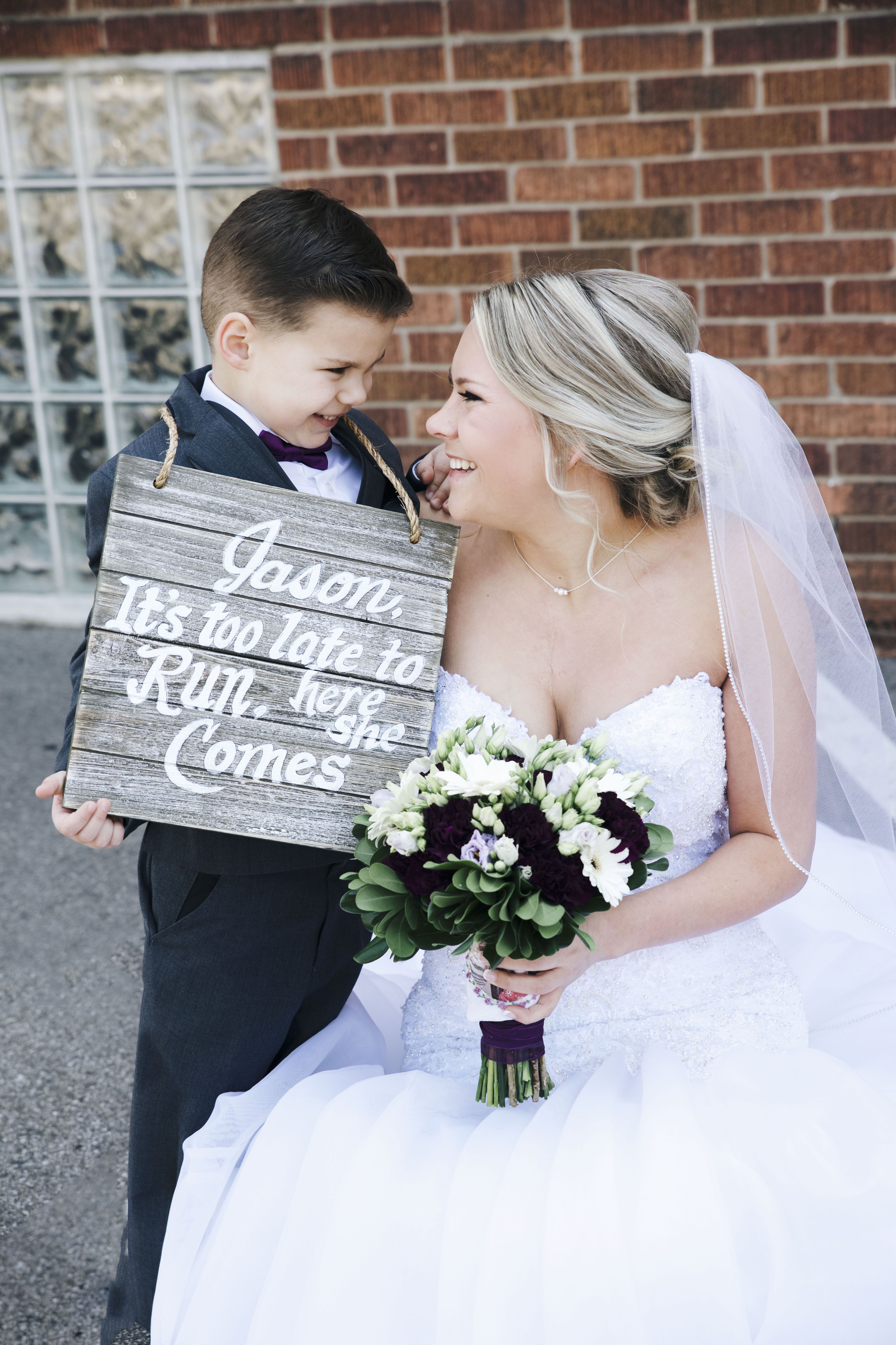 Bride and her ring bearer on her wedding day cute