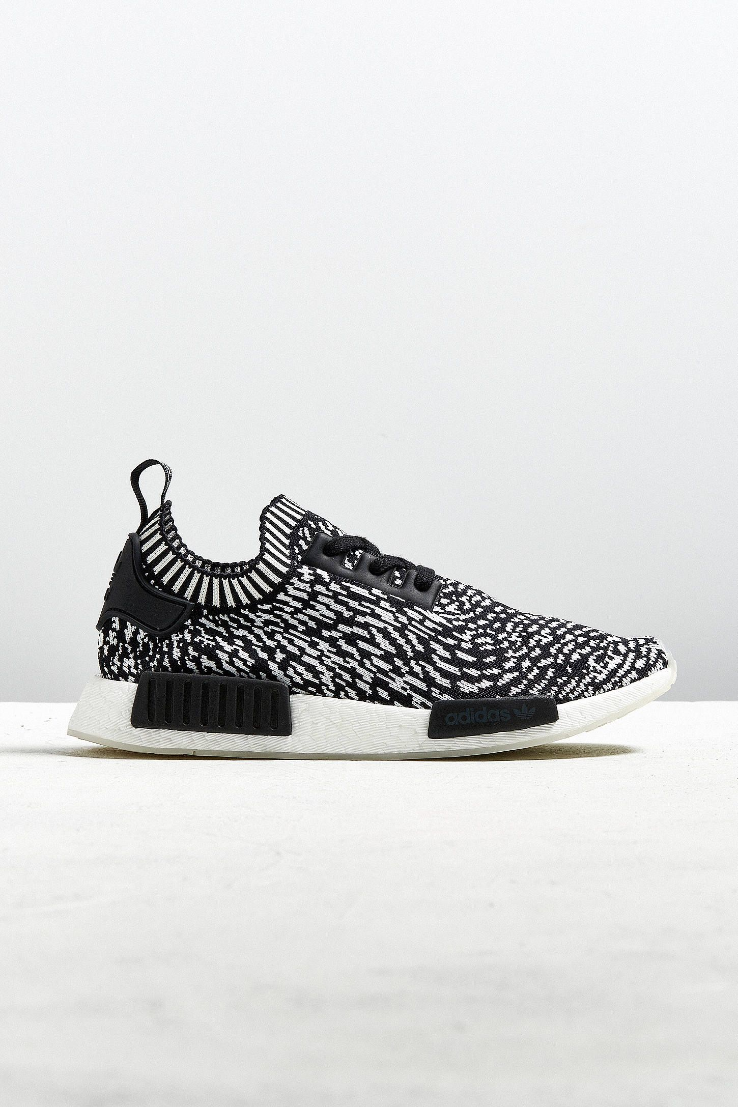 ee3bb442aa96c Shop adidas NMD R1 Spotted Primeknit Sneaker at Urban Outfitters today. We  carry all the latest styles