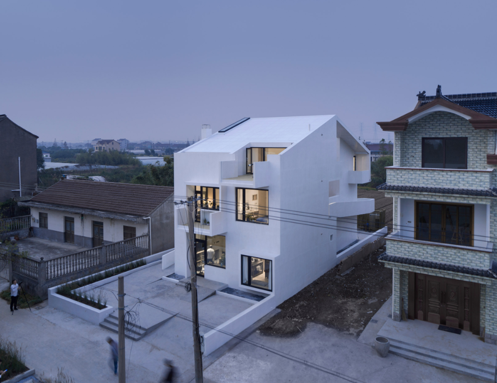 AZL Architects wraps wheelchair ramp around multi generational house in rural China