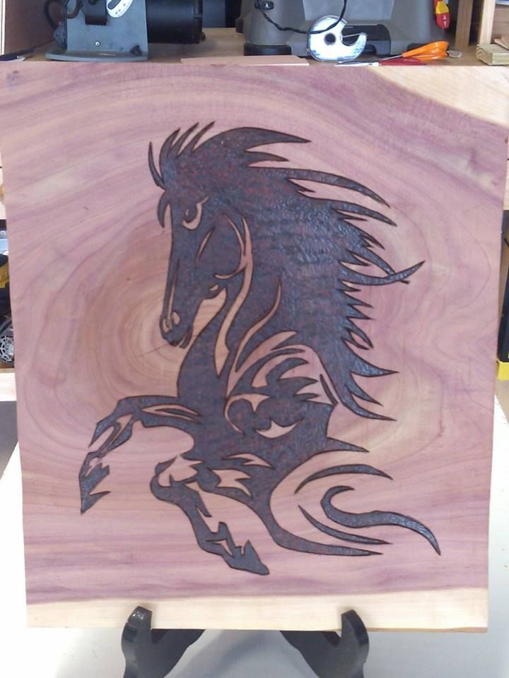 Horse coming out of sand storm. Done on Cedar