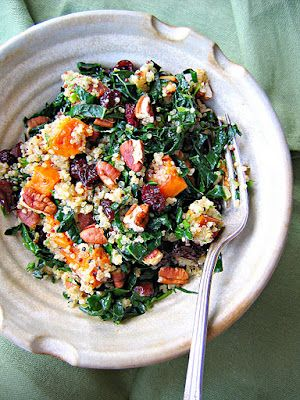 Quinoa, Kale, Sweet Potato Salad.  Made with grapes instead of dried cranberries, and chopped preserved lemon instead of lemon juice.