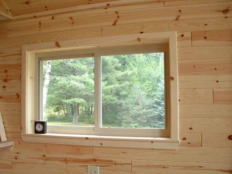 Natural horizontal knotty pine paneling on window wall for Wood trim ceiling ideas