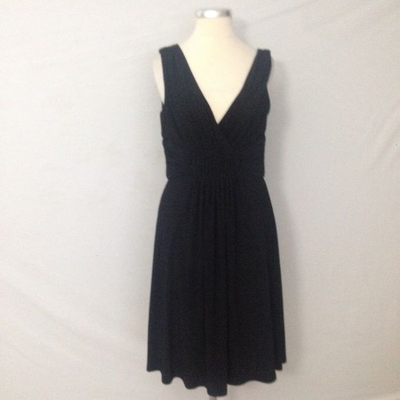 White House Black Market Little Black Dress Sz 6 Back zip Polyester/spandex Dress has a little weight and fabric will stretch  Measurements when laid flat: Bust 16 Waist 13 Hips 15 Length from top of shoulder to hem: 38 Length from under arm to hem: 30   /431/ White House Black Market Dresses