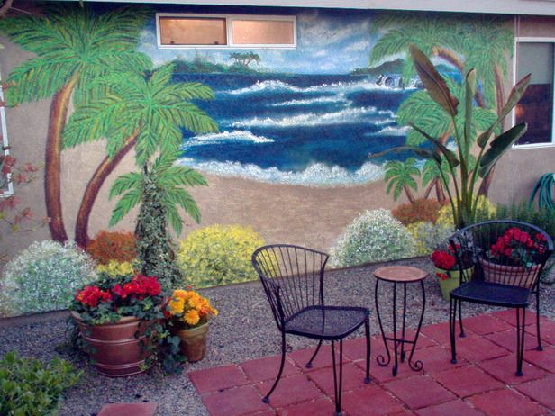 Palm Trees And Ocean Waves Were Supplied By A Wall Mural In This Patio Scene Posted By Rmser Akd Garden Mural Beach Mural Garden Art