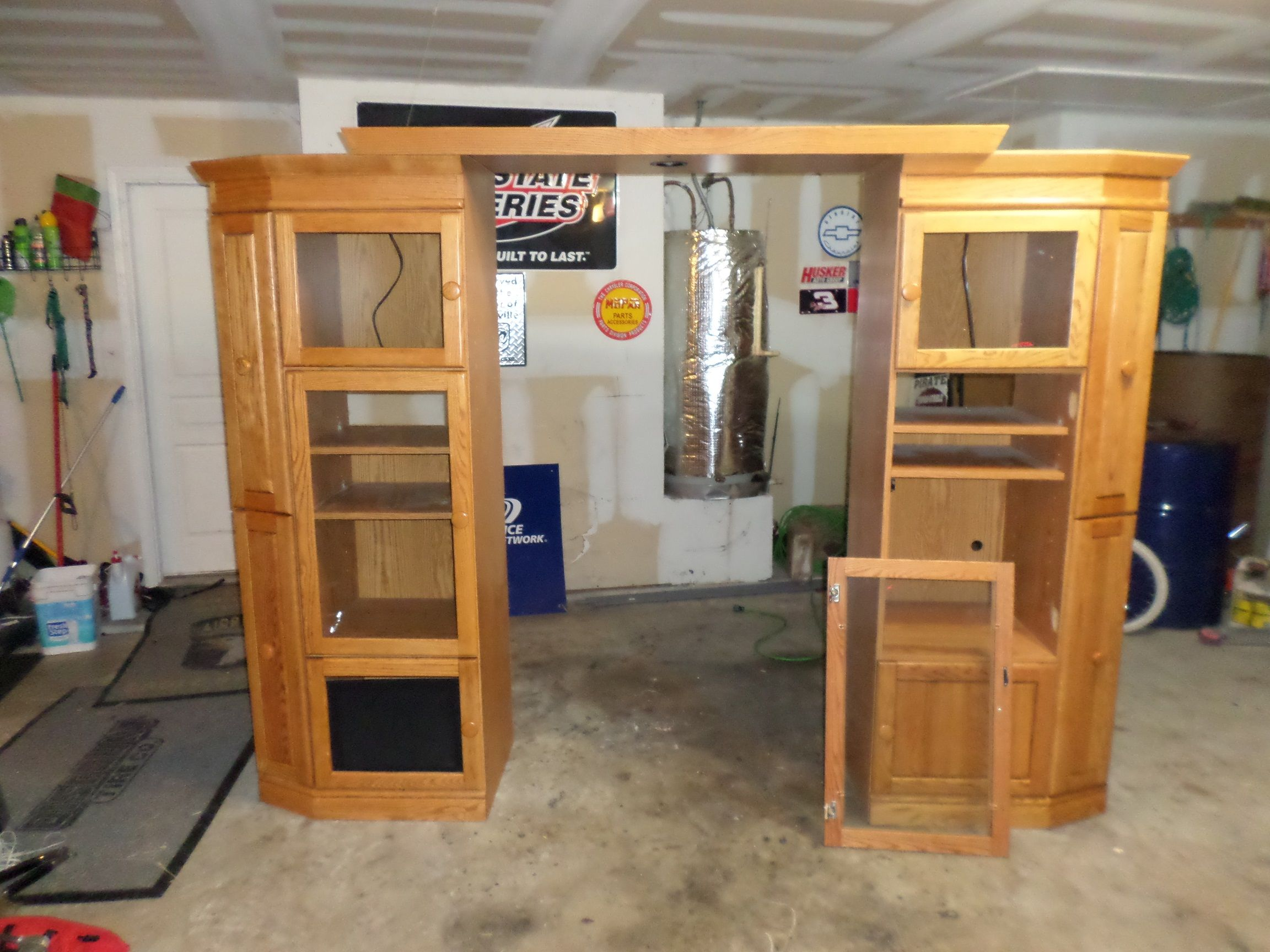 OAK entertainment center in Kurt's Garage Sale in St Paul , TX for $200. Large entertainment center fits up to a 60 inch tv. has adjustable bridge and shelving. Real wood cabinet doors and faces.one door has been pulled loose from cabinet.