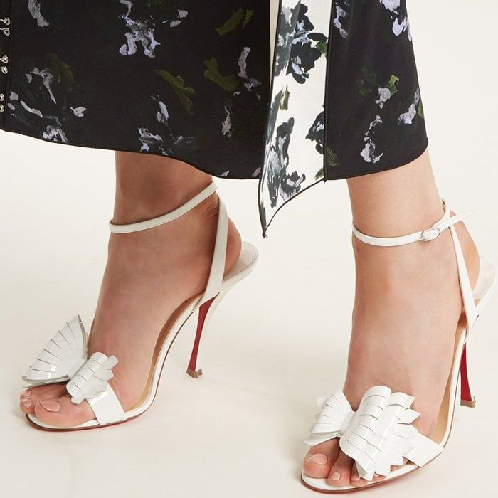 5bb151a9104 Christian Louboutin s white patent-leather Miss Valois sandals are a  timeless finisher to evening edits