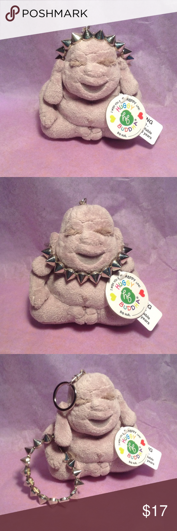 """Huggy Buddha keychain, silver-tone spiked bracelet Brand-new by Gund is a HUGGY BUDDHA plush keychain approx: 4"""" x 4"""".  On his tag it says """"I wish you a happy life,"""". BIG HUG. This is NOT A TOY! He is adorned with a excellent used condition spiked silver tone stretch bracelet. The bracelet measures 2.5 inches in diameter. It's made on double strands, very strong.  Excellent used condition. Non Branded Bracelet Jewelry Bracelets"""
