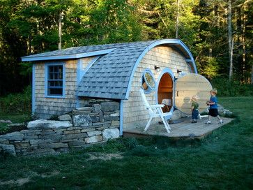 Hobbit Hole Tiny House Cottage is a playhouse
