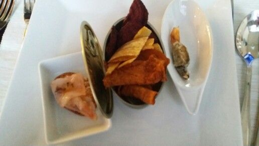 Vegetable baked crisps with Morcilla tempura accompanied by a ceviche and foie tapa