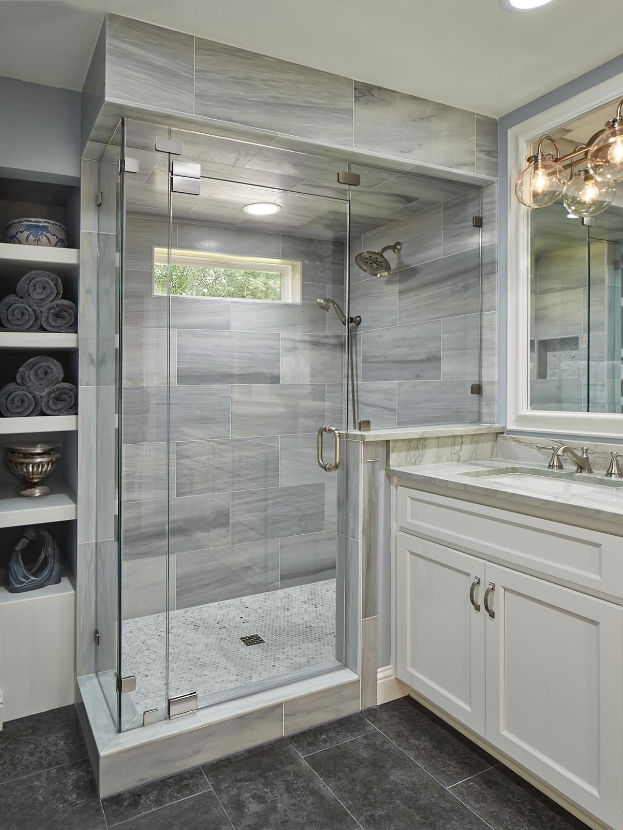Bathroom with Glass and Marble Shower Gray Limestone Floors and