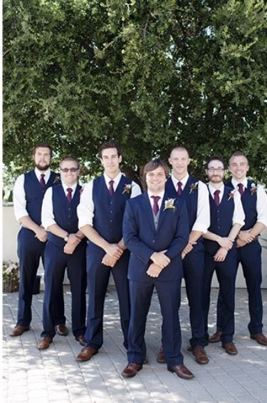 Groomsmen Party Groom In Navy Blue Suit With A White Shirt And Purple Tie