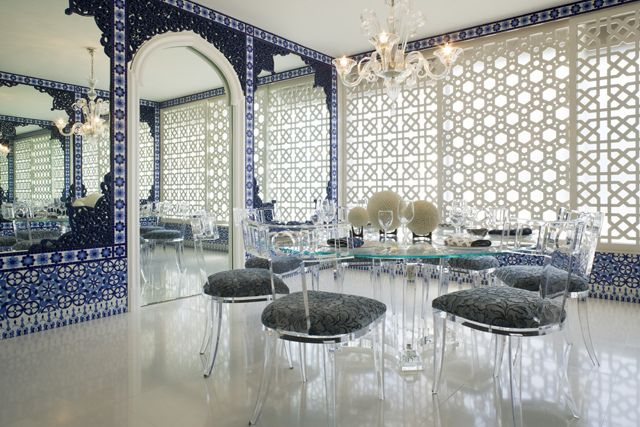 dining room in a moroccan-inspired apartment in palm beach, fl
