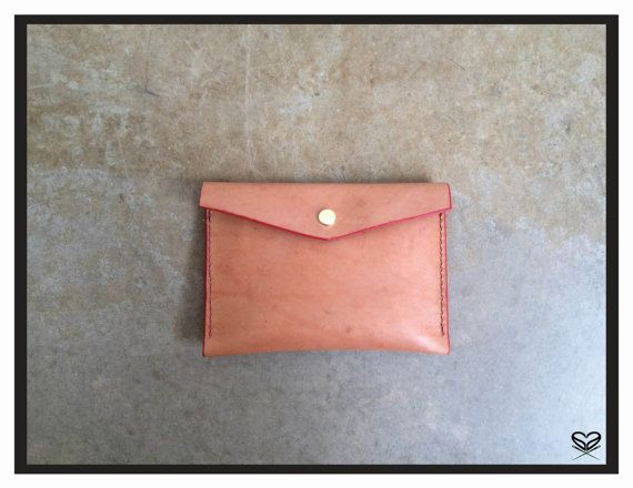 "Seaminglyartful medium envelope pouch Handmade, literally hand sewn veggie leather.    dimensions: 7"" X 5"""