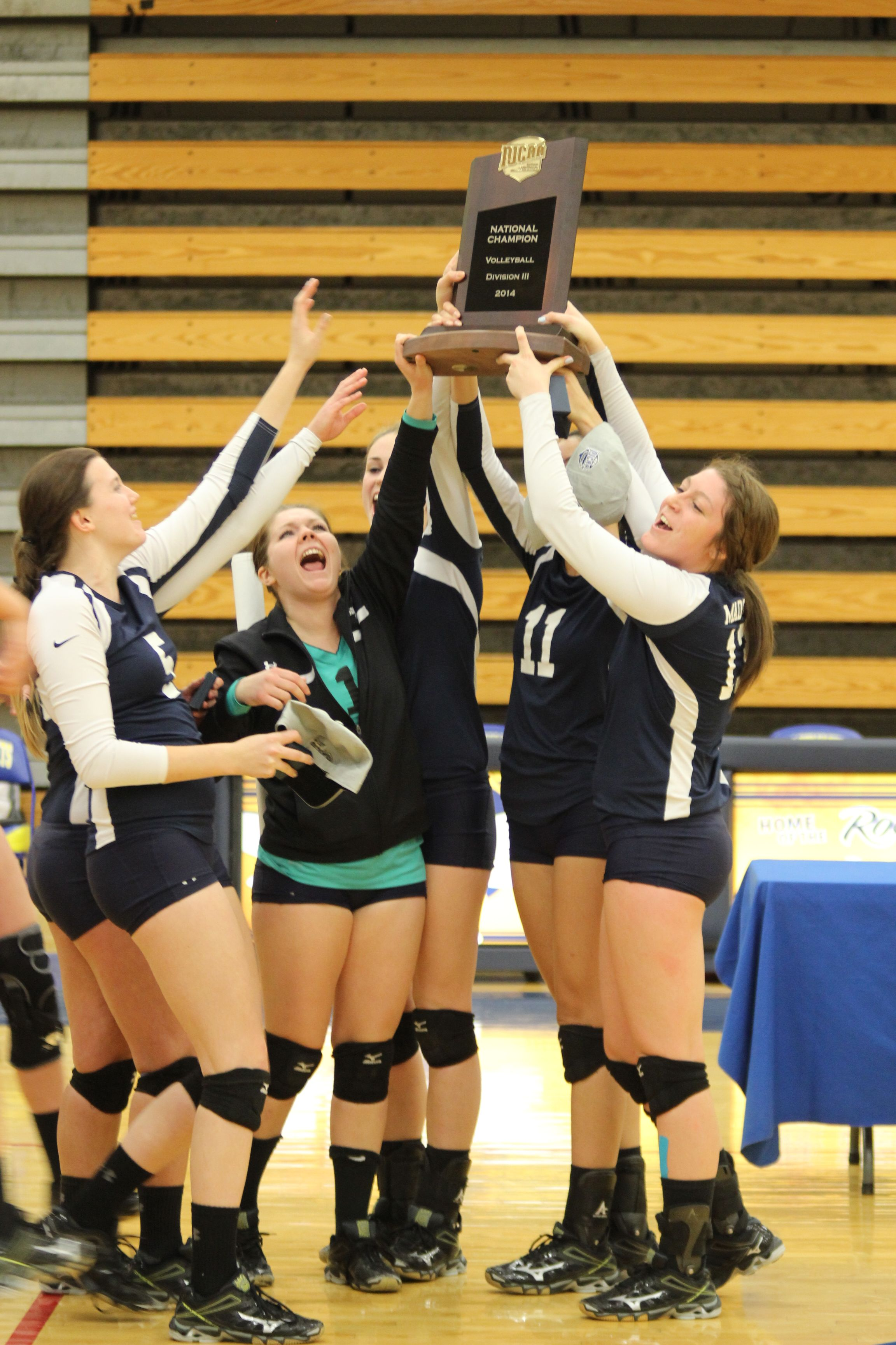 Brooke Gilbertson And The 2014 Team Hoisting Their Njcaa Diii National Championship Trophy High For All To See National Championship Women Volleyball Competing