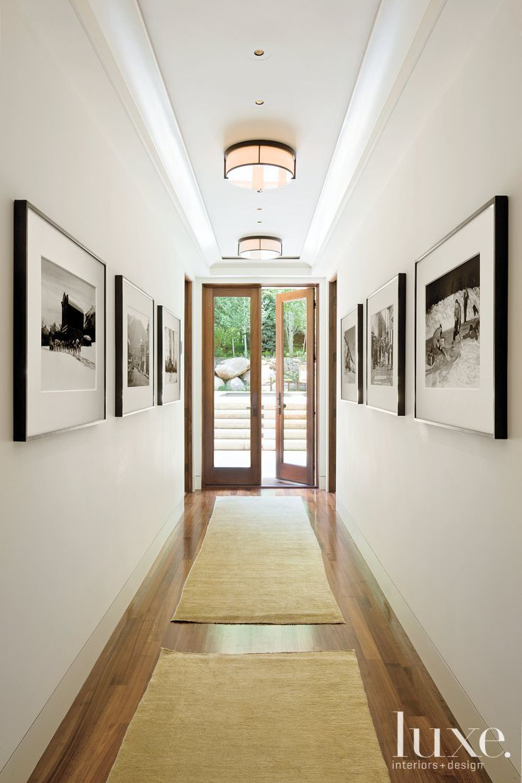 Contemporary White Hallway with Black-and-White Photos ... on red hall ideas, entrance hall ideas, little hall ideas, modern hall ideas,
