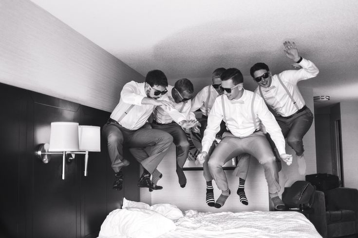 Danae marie photography funny groomsmen jumping on a bed