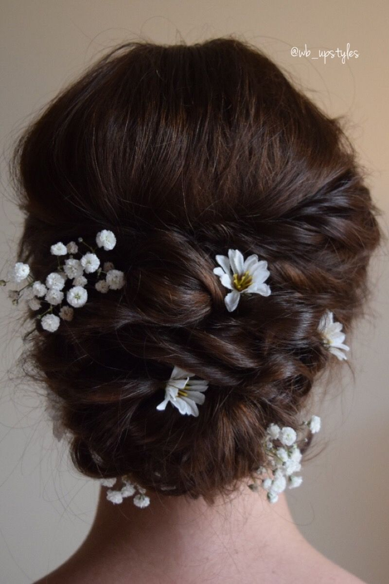 romantic bridal updo. she had chosen to use flowers in her