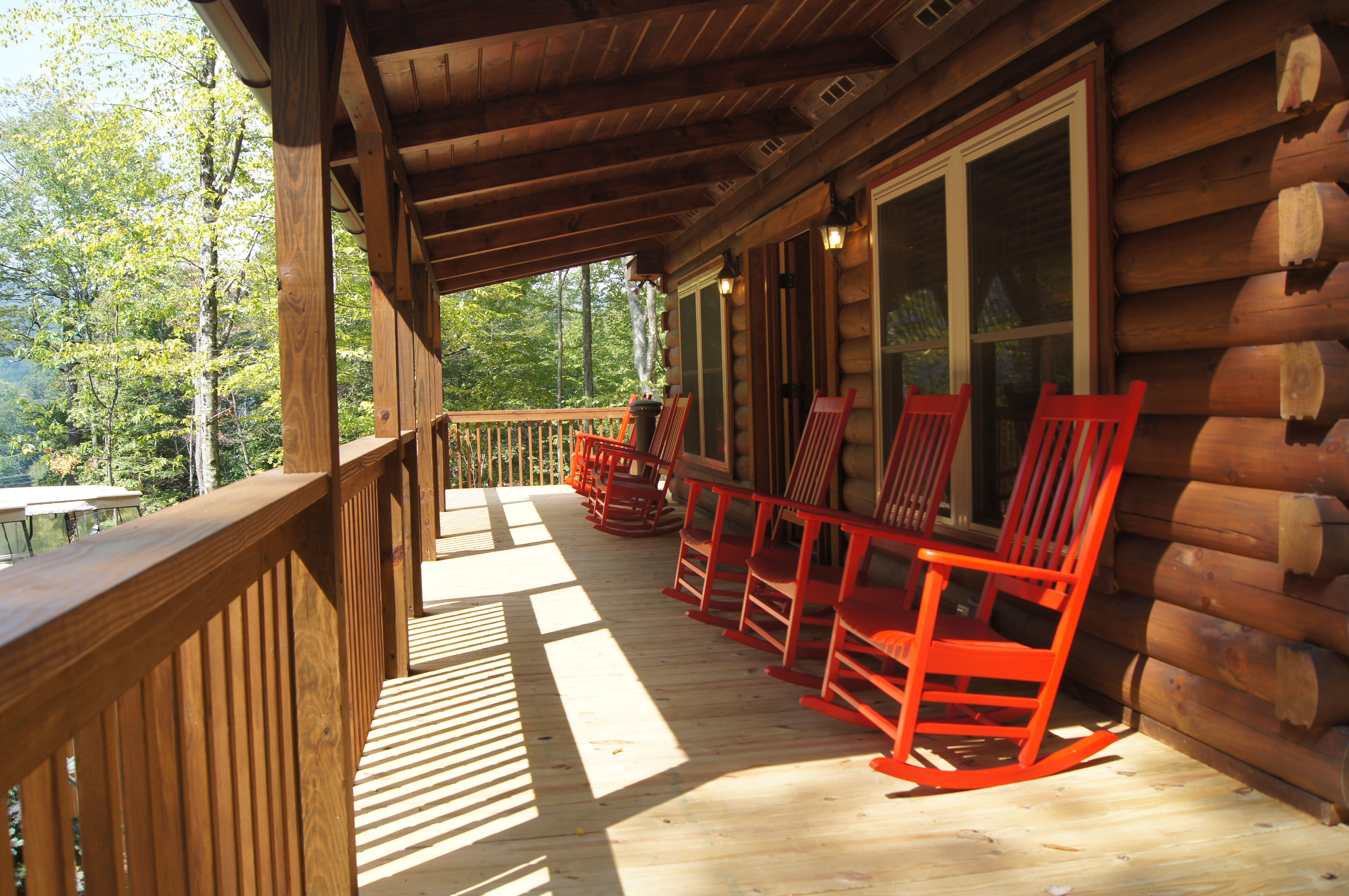 Red Rocking Chairs On A Large Front Porch Make A Beautiful Place To Relax Front Porch Furniture Cabin Porches Porch Furniture
