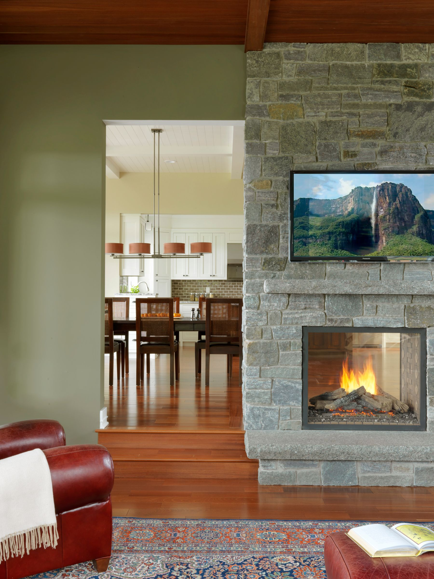 This Double Sided Fireplace Shares Its Cozy Warmth Equally Between A Sunken Living Room And