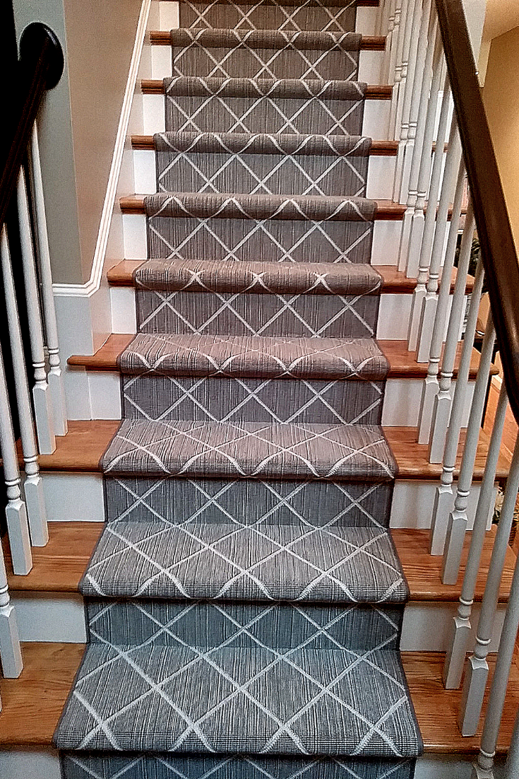 Diamond Patterned Carpet Runner Takes These Stairs A Step Up | Grey Patterned Stair Carpet | Teal | Black | Farmhouse Style | Stair Landing | Wall