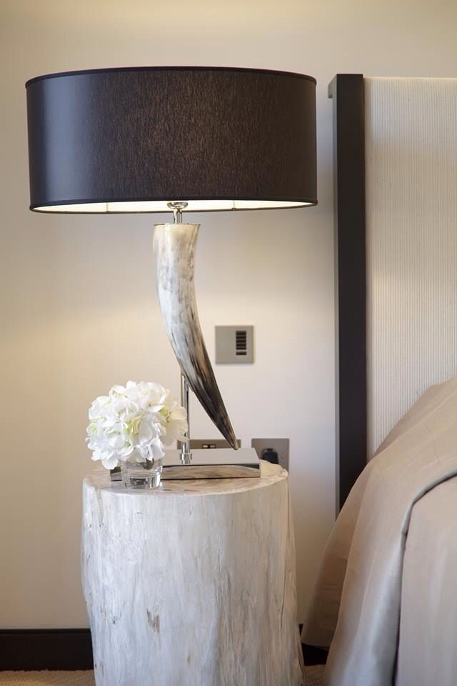 If you do not have a night table, you can create one from a garden stool, a painted stump or a small table.  This night table lamp is a piece of art on its own.  www.uniquehomesolutions.ca