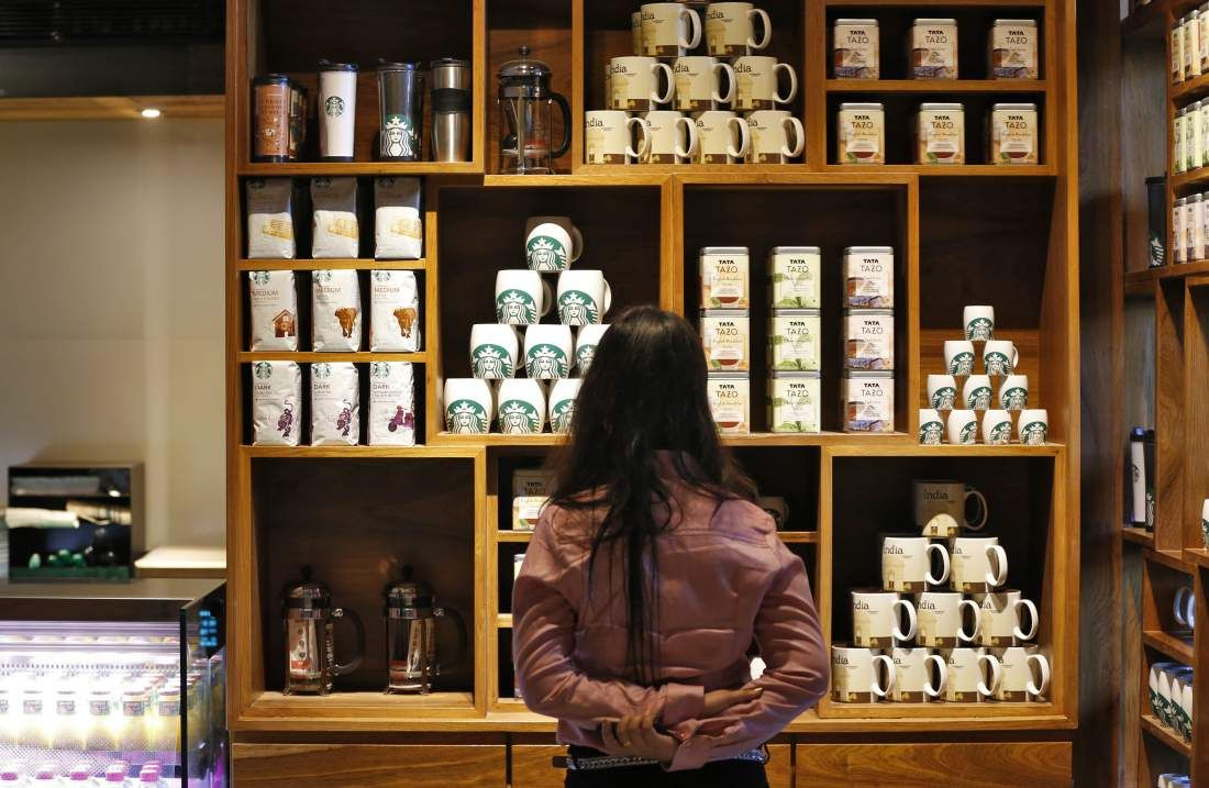 Starbucks Removes Flavorings From Indian Stores Starbucks Store Coffee Mug Display Mug Display