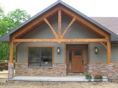 Front porch on ranch house front porch cedar truss for Back porch ideas for ranch style homes