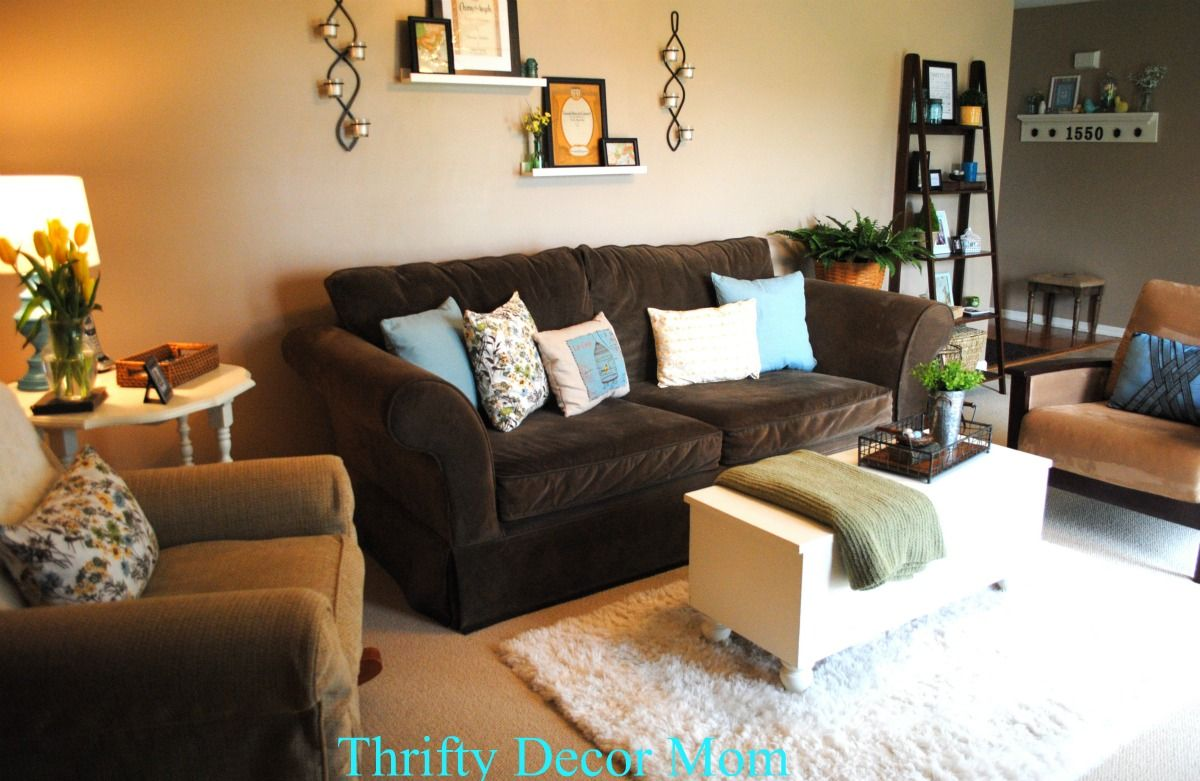 living room dark brown couch soundproof tan walls blue accents modern | all of the ...
