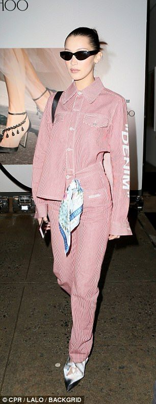 Suited and booted: Bella Hadid meanwhile kept her party look very low key in a pink stripe... #bellahadid