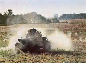 Rare color photo of German Tiger firing on enemy positions.
