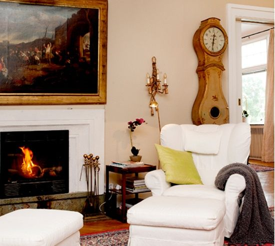White Chair By Cozy Fireplace Home Comfy Reading Chair Interior Design