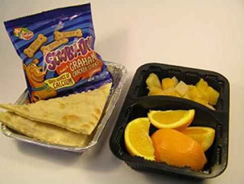 Rachel - This lunch is: Cheese Quesadilla, Orange, Pineapple, Scooby Doo Crackers