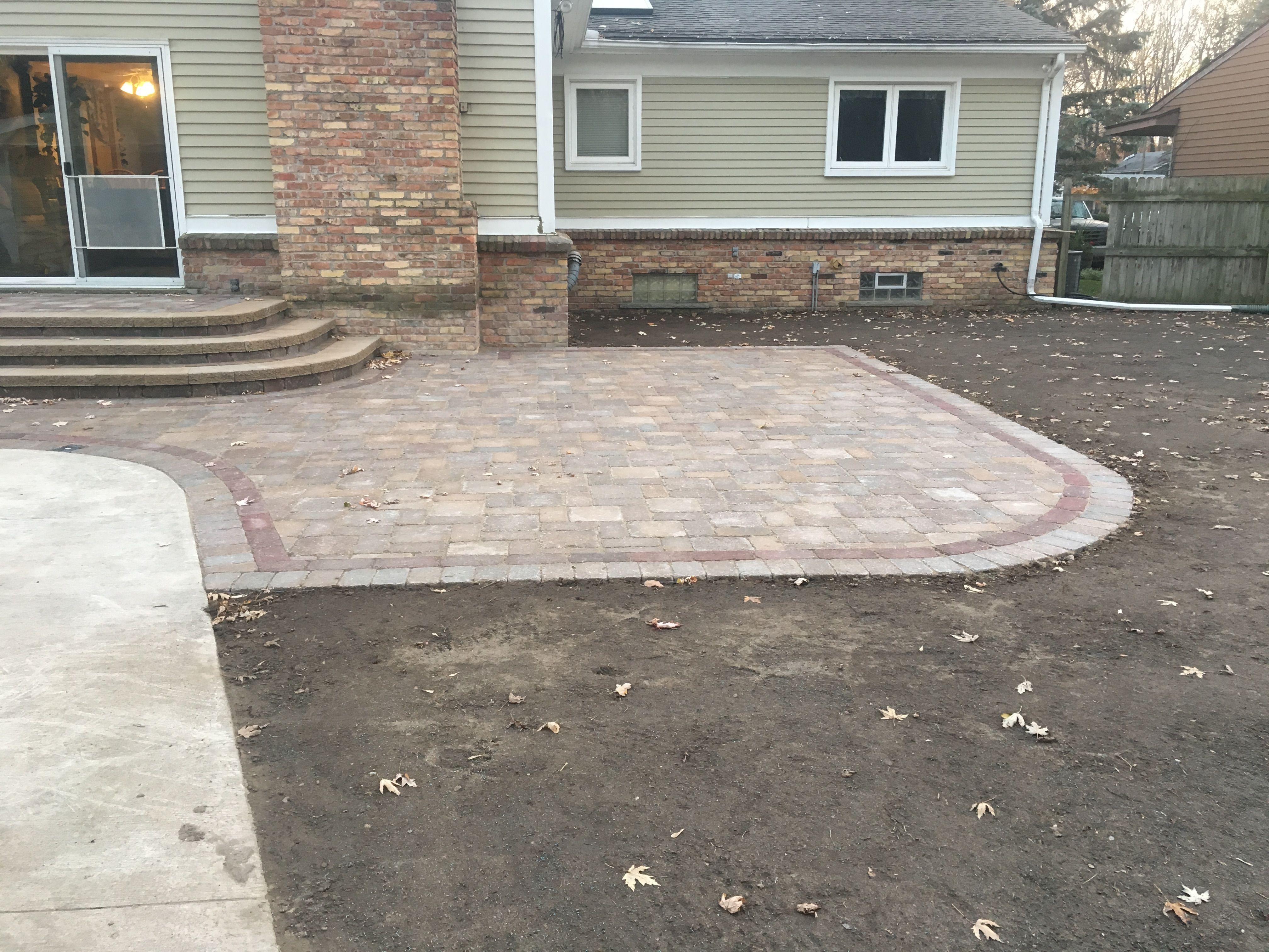 patio with old world vintage pavers and stonegate wall block