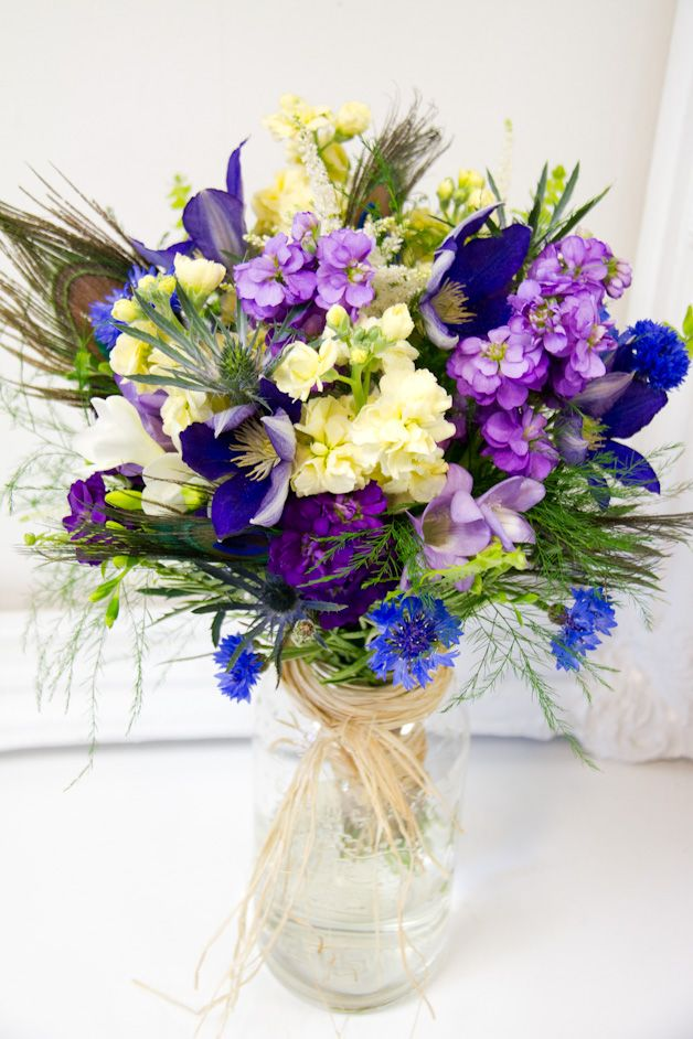 Blue Purple Cream And Soft Yellow Wedding Flowers With Peacock Feathers By Living Fresh